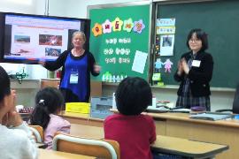An Australian and Korean teacher lead a class on Korean language together