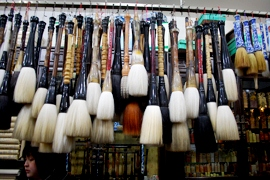 Brushes for sale at a market