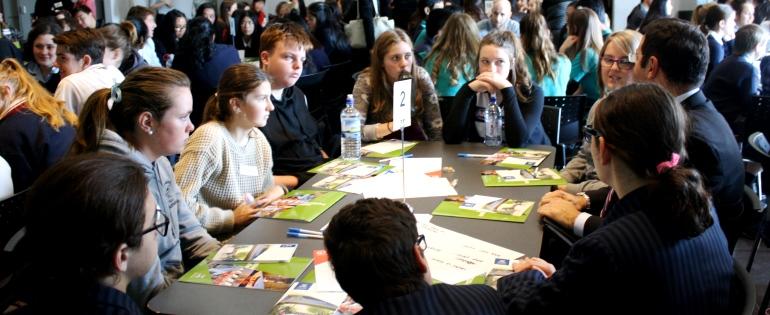 Students listen to an Asia Literacy Ambassador