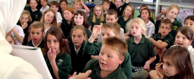 An Indonesian teacher talks to an Australia Primary School class
