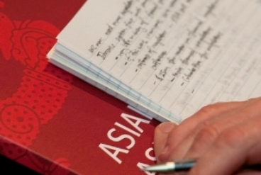 Asia Literacy folder and handwritten notes
