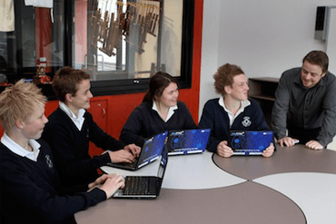 370x247 Students with laptops