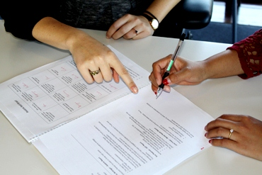 Two women working collaboratively on a document