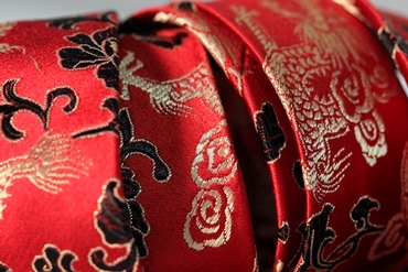 Red Japanese silk tie embroidered with gold stitching