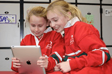 370x247 Children with iPad