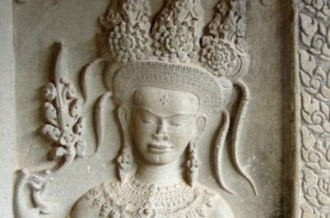 Close-up of a bas-relief of an Angkor dancer wearing an ornate headdress and jewellery