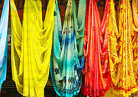 Brightly coloured scarves and tapestries
