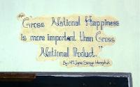 Gross National Happiness slogan on the wall of a Bhutan school