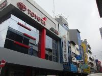 A Toyota dealership and other shops at the Goldok Shopping Centre.