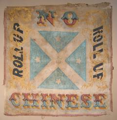 An old banner encouraging people to protest during the Gold Rush against Chinese immigrants