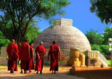 Monks dressed in their red robes visit Sanchi stupa