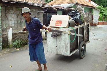 Man takes away garbage from a street