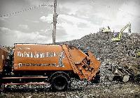Orange rubbish truck in Indonesia
