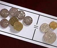 Coins on a grid with an equals sign