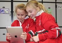 Elsternwick Primary students play on an iPad together