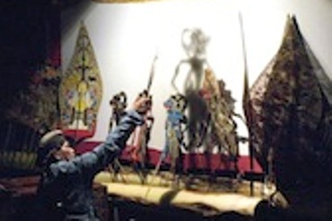 A wayang puppeteer performing