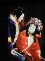 The female Banraku puppet looks up at the male Banraku puppet
