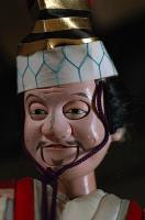 Close-up of the smiling face of a Sanbaso Bunraku puppet