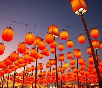 Orange lanterns lighting up night sky