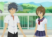Screenshot of an anime cartoon of a young boy and girl talking together