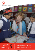 Australian teacher explaining a lesson to two Indian teachers