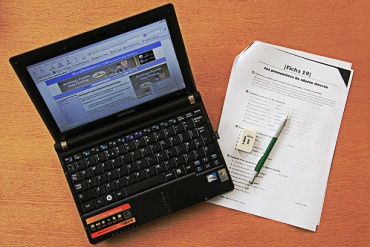 A laptop and an language exercise booklet