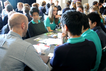 An Asia Literacy Ambassador talks with students